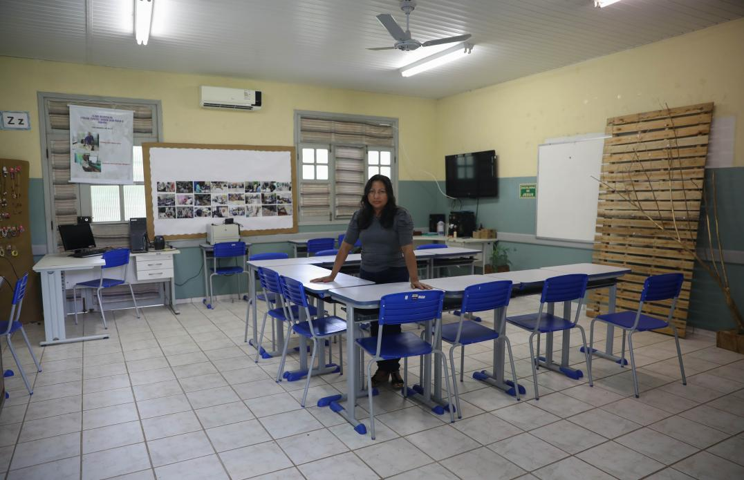 In the midst of summer vacation, Ediana Barbosa stops by her classroom to prepare for the next semester. Image by Anton L. Delgado. Brazil, 2020.