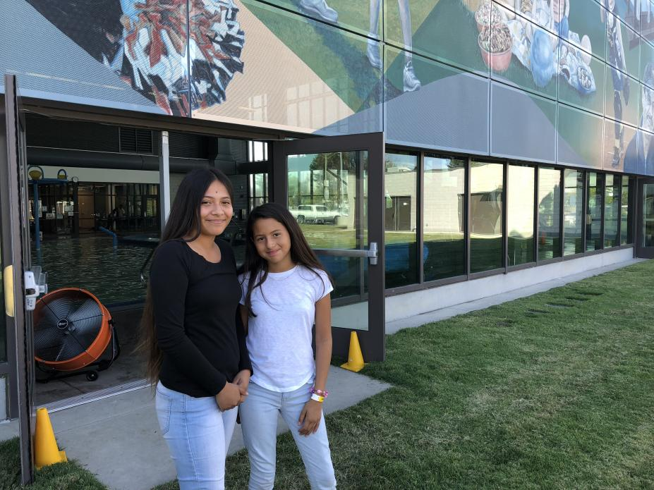"Destiny and Adrianna pose for a photo outside the East Oakland Sports Center. ""I feel like we relate to each other,"" Destiny says of her fellow campers. ""It's hard on all of us, but we just have to take care of one another while we're here."" Image by Jaime Joyce for TIME Edge. California, 2018."