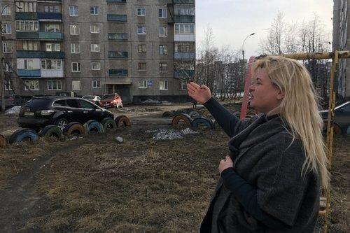 Anna Kireeva near some of the Soviet-era apartment blocks Murmansk, Russia. Image by Amy Martin. Russia, 2018.