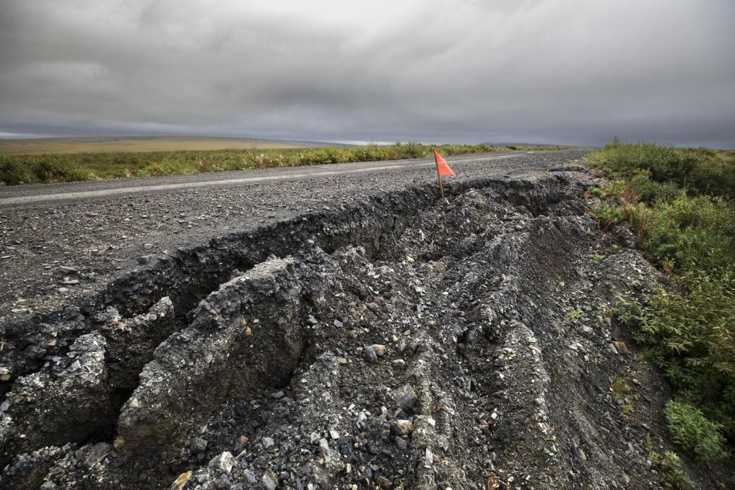 In a warming Northwest Alaska climate, maintenance costs are mounting on this 73-mile road that connects Nome to the community of Teller. Permafrost under this route is thawing, causing settling, cracking and sloughing that require more frequent repairs. Image by Steve Ringman. United States, 2019.