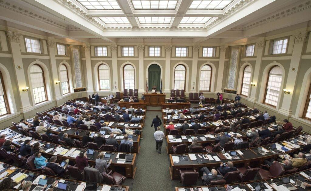 The Maine House of Representatives argues a bill on the floor aimed at more analysis of the proposed New England Clean Energy Connect project at the State House in Augusta on June 4, 2019. Image by Michael G. Seamans. United States, 2019.