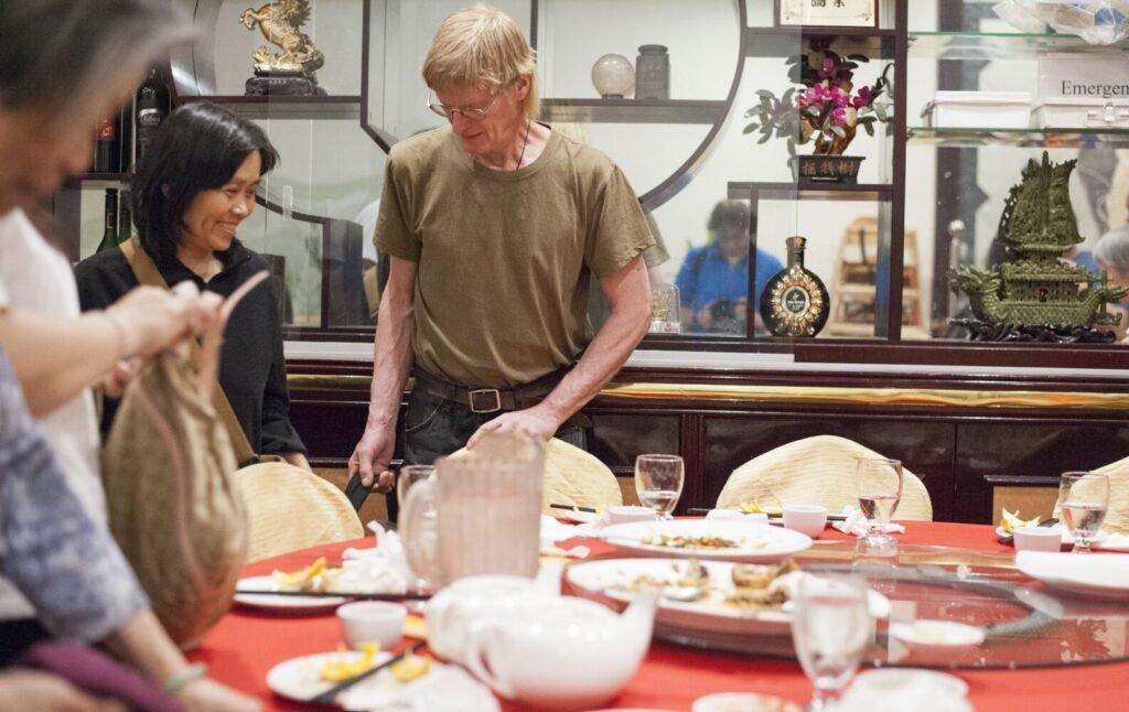 Sally Kwan and Duane Hanson finish dinner with Sally's family in Chinatown, Manhattan, on May 19, 2019. Image by Michael G. Seamans. United States, 2019.