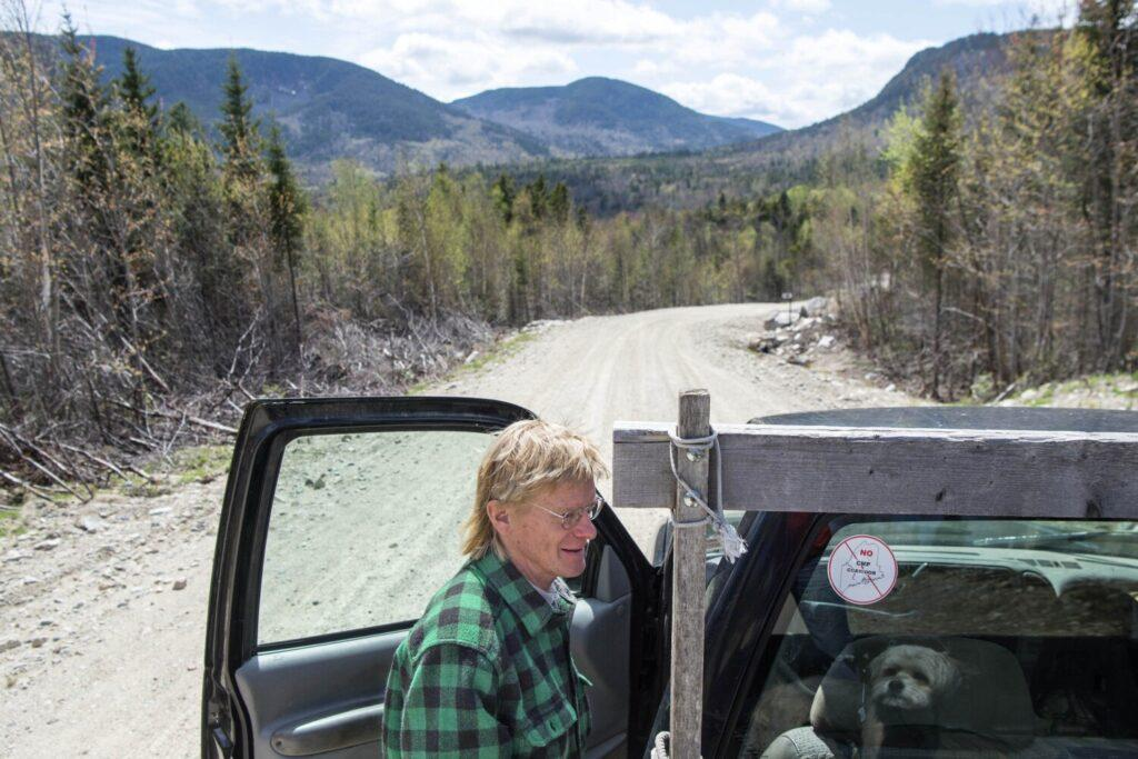 Duane Hanson hops in to his truck on Spencer Road in the Unorganized Territories in the north woods of Maine near T5 R7 on May 27, 2019. The proposed power line corridor will pass across the road at this location. Image by Michael G. Seamans. United States, 2019.