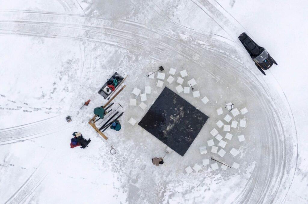 Duane Hanson hauls 16-inch square blocks of ice from his pond in T5 R7 in the Unorganized Territories on Jan. 4, 2020. The ice will be stored in an ice house with saw dust to be used to refrigerate food throughout the year. Image by Michael G. Seamans. United States, 2019.