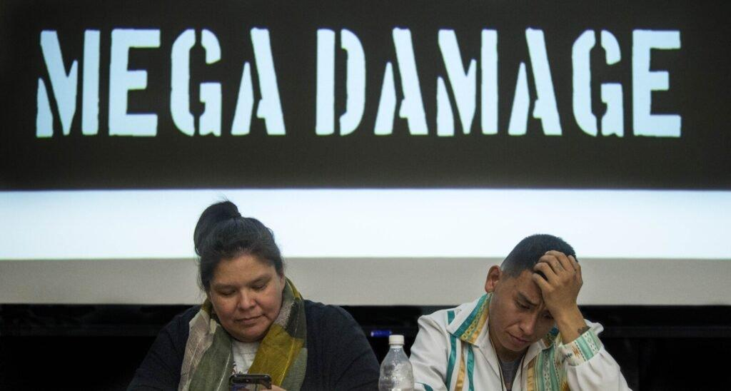 Loretta Miswaggon, left, and Carlton Richards, both of Pimicikamak Territory in Manitoba, Canada, prepare to talk about the impacts of 'mega-dam' hydropower has had on indigenous tribes in Manitoba during a speaking tour at Preble Hall at the University of Maine in Farmington on Nov. 25, 2019. Image by Michael G. Seamans. United States, 2019.