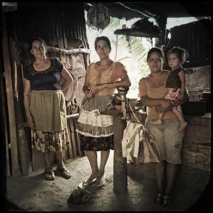 Las Brisas: Four generations depend on this large cook stove in the middle of their house. Most people in this community struggle daily to find wood and provisions to operate the stoves, which are not energy efficient. Image by Lynn Johnson. Guatemala, 2017.