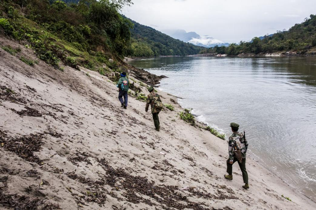 Villagers and Kachin Independence Army officers walk into the Chipwi dam project area, which was stopped in 2012 due to fighting in Chipwi, Kachin State, Myanmar. Image by Hkun Lat. Myanmar, 2019.