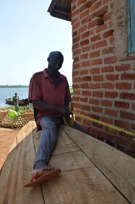 A fisherman working in Walumbe village. When the demarcation of the buffer zone is complete, many Walumbe residents may be made to leave the area, according to NEMA. Image by Annika McGinnis. Uganda, 2019.