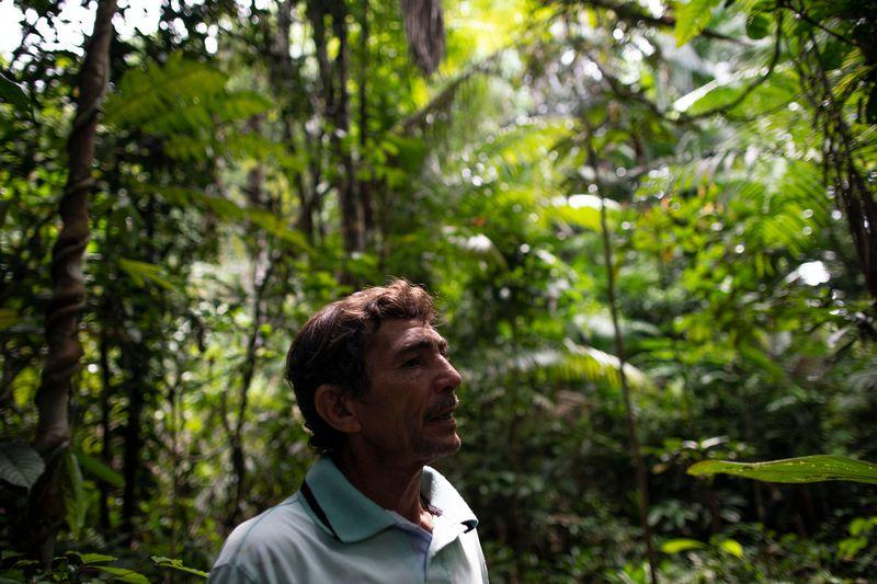 Elias da Silva Lima, 63, walks through the forest between his home and a clearing he farms on the Virola Jatoba settlement in Anapu. Image by Spenser Heaps. Brazil, 2019.