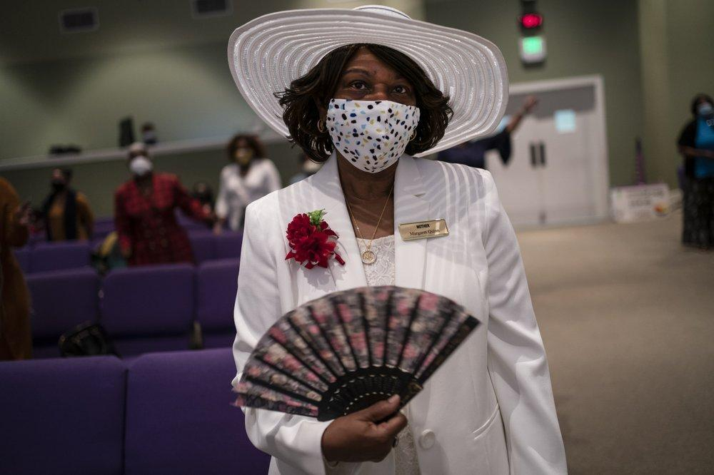 A woman wearing a face mask attends a church service at the New Horizon Church International in Jackson, Miss. Image by Wong Maye-E/AP Photo. United States, 2020.