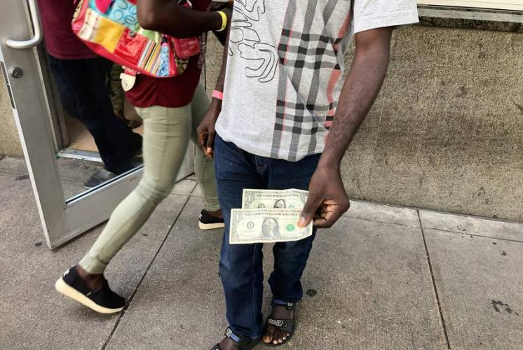 Evaristo, a migrant from Angola traveling with his wife and three kids, arrived at San Antonio's Migrant Resource Center the last week of June with $2 in his pocket. Image by Jay Root. United States, 2019.
