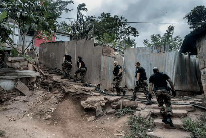 Gendarme Nationale officers on patrol in the village of Majicavo Koropa, Mayotte. Image by Tommy Trenchard. Comoros, 2019.