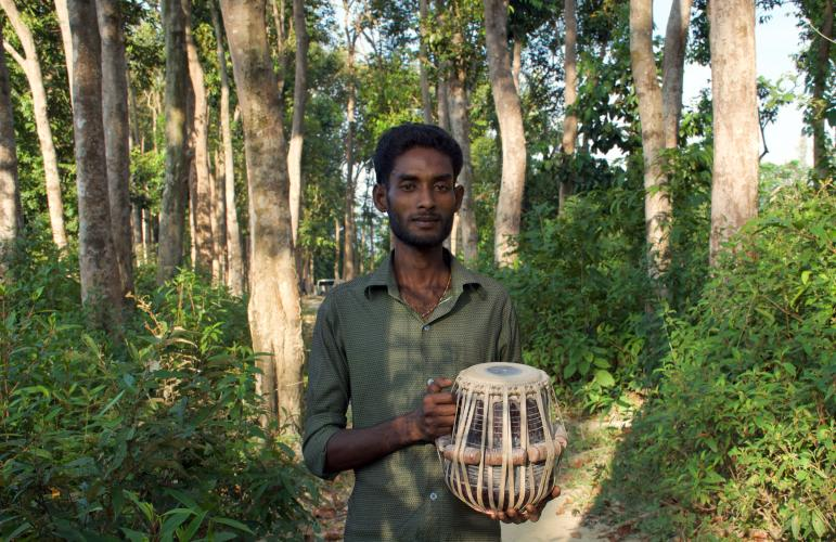 Sayed learned to play the tabla drums on St. Martin's Island, a vacation destination in Bangladesh. Image courtesy Music in Exile. Bangladesh, 2019.