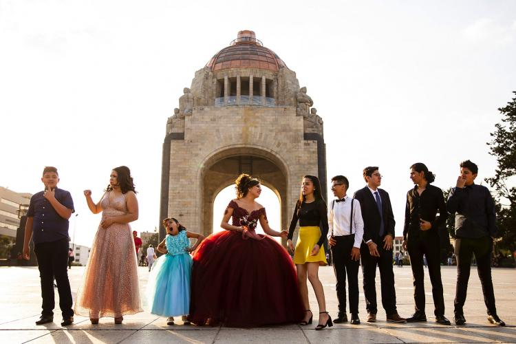 Leslie Valeria, center, prepares for a photo session for her quinceañera at Monumento a la Revolución in Mexico City. Image by Erika Schultz. Mexico, 2019.