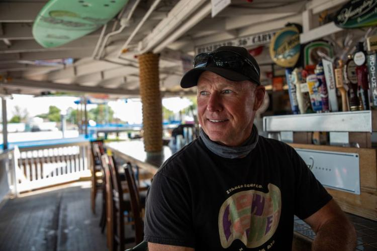 Tom Frank, owner of Captain Jack's Good Time Tavern, at his restaurant on Lake Ontario in Sodus Point, New York, on July 30, 2020. He has suffered flood damage twice since 2017. Image by Zbigniew Bzdak/Chicago Tribune. United States, 2020.