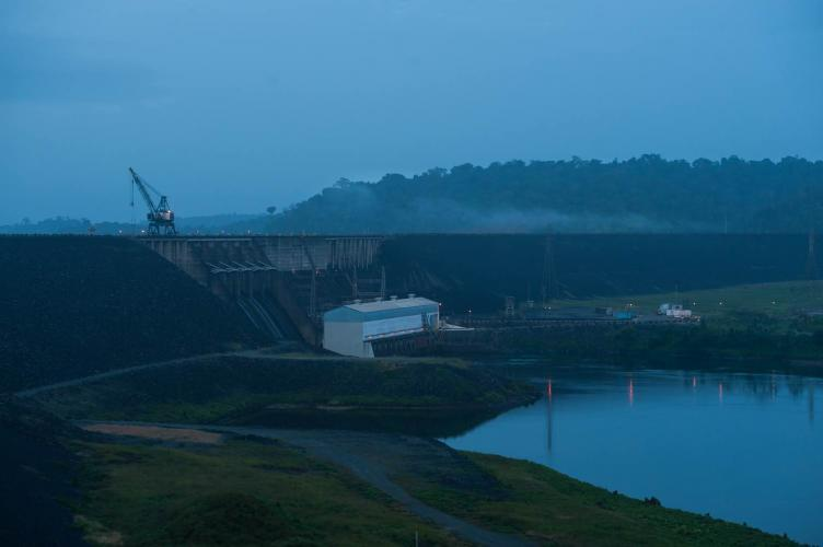 Alcoa's plans to leave the country have left the ownership of the Afobaka Dam — here, at dawn — up for debate. Image by Stephanie Strasburg. Suriname, 2017.