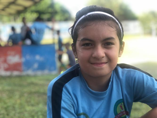 Astrid Ponse, 12, of Villanueva, loves watching the U.S. Women's National Team play soccer and listening to the British rock band Queen. Image by Jaime Joyce/TIME for Kids. Honduras, 2019.