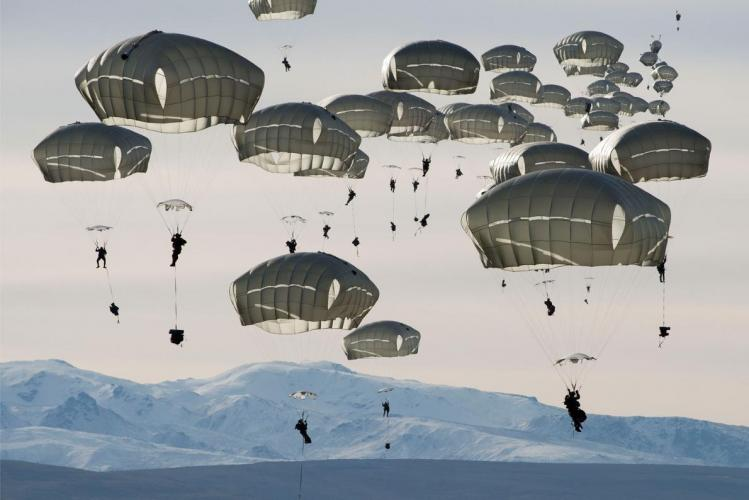 U.S. soldiers drop over the Donnelly Training Area near Fort Greely, Alaska. In October 2018, the training area hosted some 6,000 soldiers during a war games exercise named Arctic Anvil. Image by Louie Palu. United States, 2018.