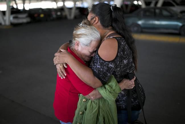Bertha Arias (left) cries as she says goodbye to Elena before walking to the international bridge to try to ask U.S. immigration authorities for permission to stay in the U.S. with her family as she waits for her asylum appeal. Image by Ivan Pierre Aguirre. Mexico, 2019.