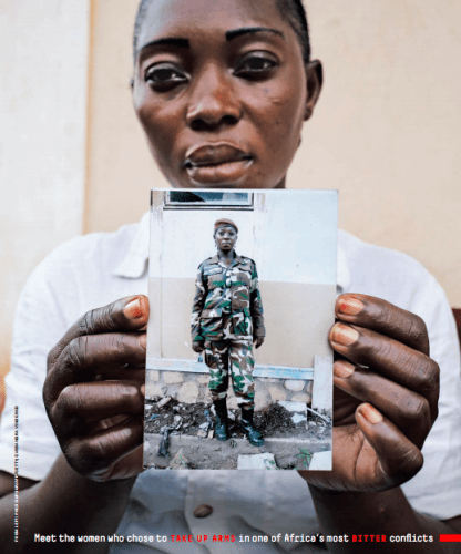 Marie-Yvette, photographed in Bangui on September 24, holds an undated picture of herself in her Séléka uniform. Image by Cassandra Vinograd. Central African Republic, 2017.