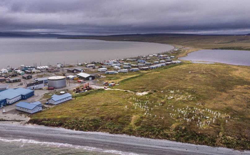 Teller is a Northwest Alaska coastal community born from a gold rush more than a century ago. Now an Inupiaq village, it faces threats from rising seas and stronger winter storms that have been eroding a bluff. On that bluff, the crosses of a cemetery are crooked due to thawing permafrost. Image by Steve Ringman. United States, 2019.