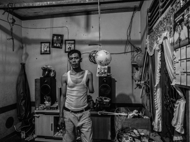 Misnan at home with the toys he sells around the village, which earn him only about $4.75 a week. Image by Xyza Cruz Bacani. Indonesia, 2018.