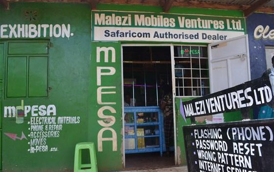 Technology business where people in the community can handle m-pesa transactions and other tech needs in Kenya. Image by Janelle Richards. Kenya, 2017.