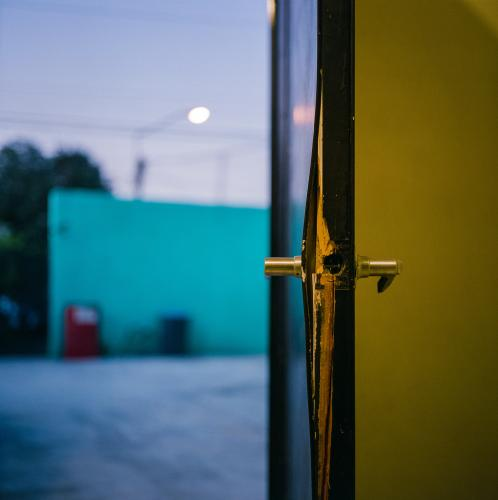 A broken door suggesting forced entry at the previous home of activist Jessica Molina. Image by by Christopher Lee. Mexico, 2020.