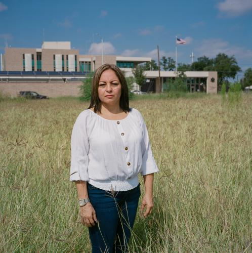 Maria Elena Dominguez in front of the United States Consulate in Nuevo Laredo, Mexico. Image by by Christopher Lee. Mexico, 2020.