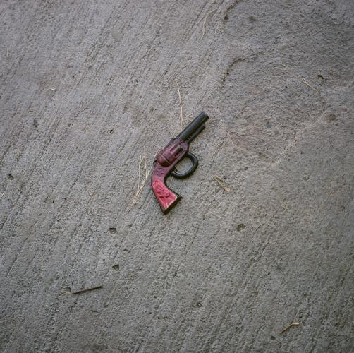 A toy gun is seen in front of the home of Reyna Patricia Ambroz Zapatero, September 25, 2020. Image by by Christopher Lee. Mexico, 2020.