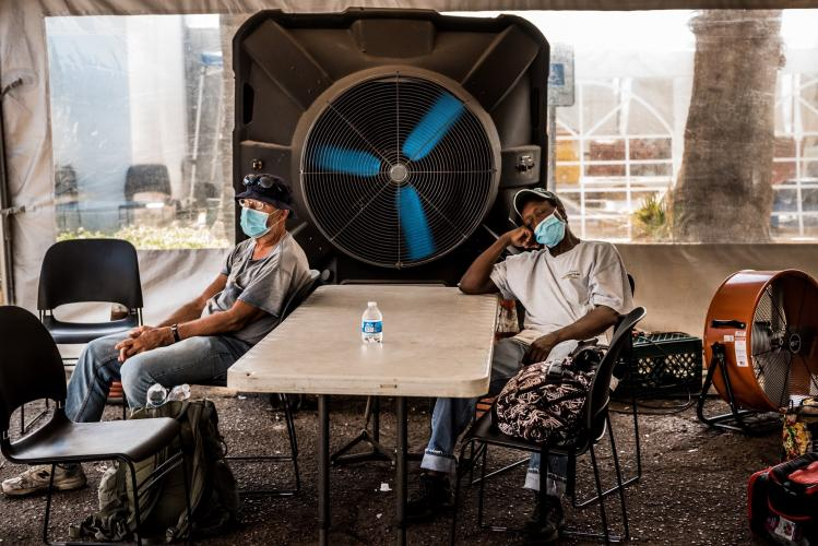 PHOENIX. People at a cooling center during Arizona's record-setting heat wave. Image by Meridith Kohut. United States, 2020.