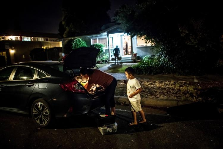 SONOMA COUNTY, CALIF. Erika González and her son, Kevin, evacuating their home as the L.N.U. Lightning Complex fire approached in August. Image by Meridith Kohut. United States, 2020.