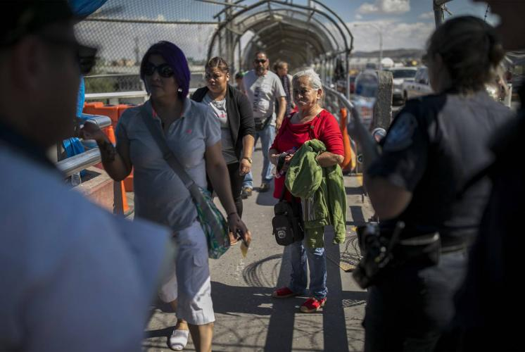 A dejected Bertha Arias of Honduras looks back at her lawyer from the top of the international bridge connecting El Paso and Juárez after being denied entry into the U.S. Image by Ivan Pierre Aguirre. Mexico, 2019.