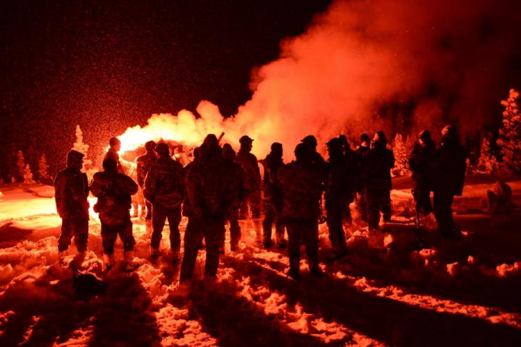 Air crews learn how to use emergency flares during cold weather survival training at the U.S. military's Northern Warfare Training Center in Black Rapids, Alaska. Image by Louie Palu. United States, 2018.