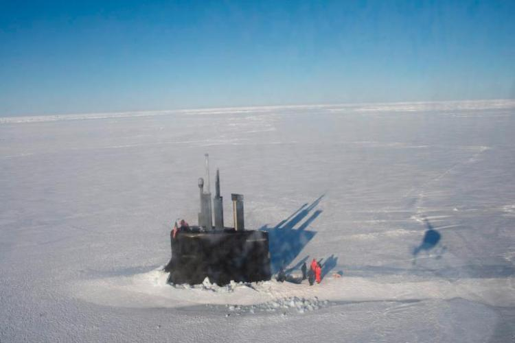 By punching a hole through thick pack ice, the U.S.S. Connecticut, a nuclear attack submarine, is transformed into a temporary floating platform during an exercise in the Beaufort Sea. With no bases in Alaska above the Arctic Circle, the U.S. relies heavily on submarines and aircraft to patrol its northern territory. Image by Louie Palu. United States, 2018.