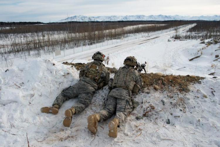 U.S. Army troops practice defensive tactics at Fort Greely, Alaska. The fort is a launch site for interceptor missiles that are designed to shoot down incoming ballistic missiles—like those North Korea has said it now possesses. Image by Louie Palu. United States, 2018.