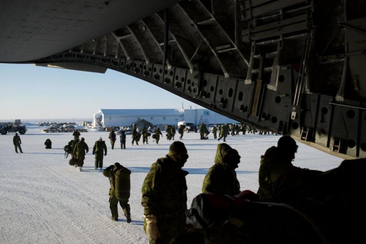 Canadian soldiers disembark from a CC-117 cargo plane during a training mission in Hall Beach, Nunavut. Image by Louie Palu. Canada, 2018.