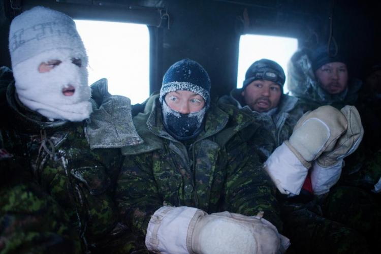 Frost-faced members of a Canadian aircrew head back to hot meals and showers after enduring a week of temperatures as low as -60°C during an outdoor survival course. Image by Louie Palu. Canada, 2018.