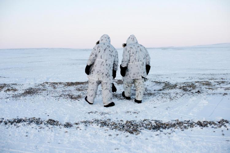 """Keep moving"" is a key principle in Arctic military operations, when anything—or anyone—standing still long in subzero temperatures risks freezing in place. Here, Canadian Captain Wayne LeBlanc and Master Corporal Jeff Valentiate walk north on Cornwallis Island. Image by Louie Palu. Canada, 2018."