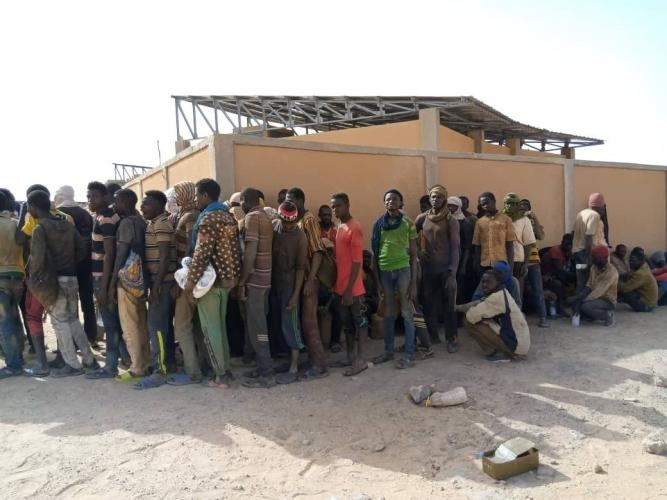 Some of nearly 100 Nigeriens arrive in Assamaka, Niger, on foot from Algeria and now must be quarantined for two weeks at the remote Sahara border settlement, where water is scarce and midday temperatures reach over 110 degrees (45 degrees Celsius). (IOM Niger via AP)