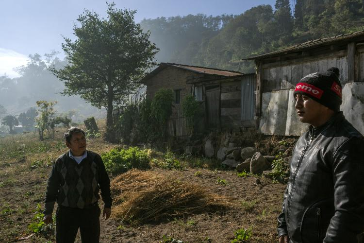 Elias López and his grandfather Julio stand in front of the property they have put up as bank collateral. Image by Mauricio Lima. Guatemala, 2019. </p> <p>