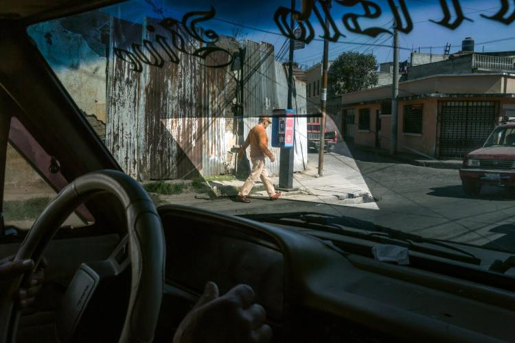 Julio López, Elias's grandfather, drives outside the city of Quetzaltenango. Image by Mauricio Lima. Guatemala, 2019.<br />