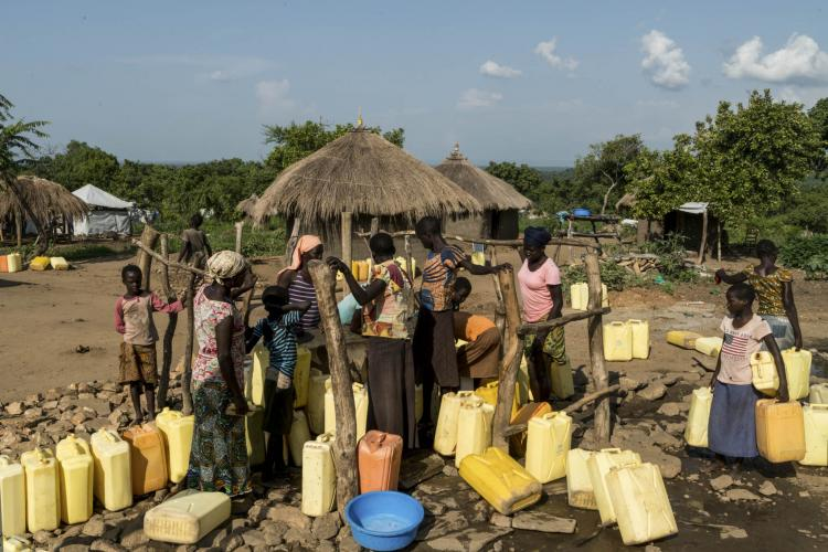 Women collect water from a borehole in the Omugo camp for refugees that have fled from South Sudan to Uganda.