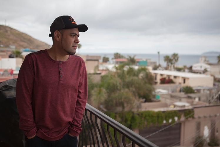 Miguel Pérez looks out over Tijuana from his balcony. Mexico, 2019. Image by Erin Siegal McIntyre.