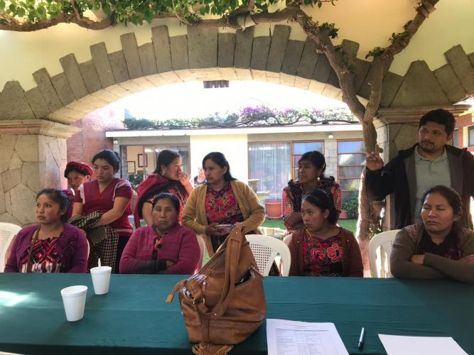 Family members from the Foundation for Justice and the Democratic Rule of Law gather on Dec. 3, 2018, at the Mexican consulate in Quetzaltenango, Guatemala for a yearly update on the ongoing investigation of their missing loved ones. Image courtesy of La Fundación Para La Justicia y El Estado Democrático de Derecho. Guatemala, 2018.