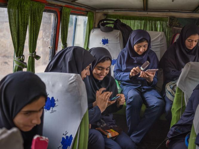Girls spend nearly two hours en route to Bibi Maryam Boarding School. Most of their families are nomads who move into village houses to enable the students to attend school during the week. Image by Newsha Tavakolian. Iran, 2018.
