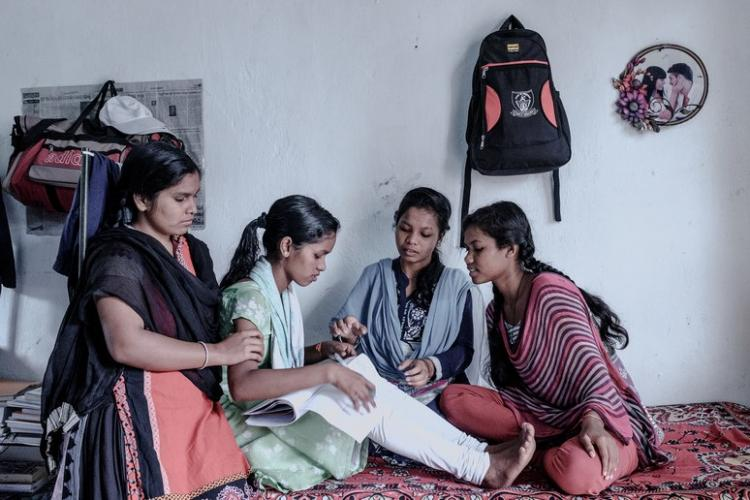 Purnima with her roommates. Image by Arko Datto. India, 2018.