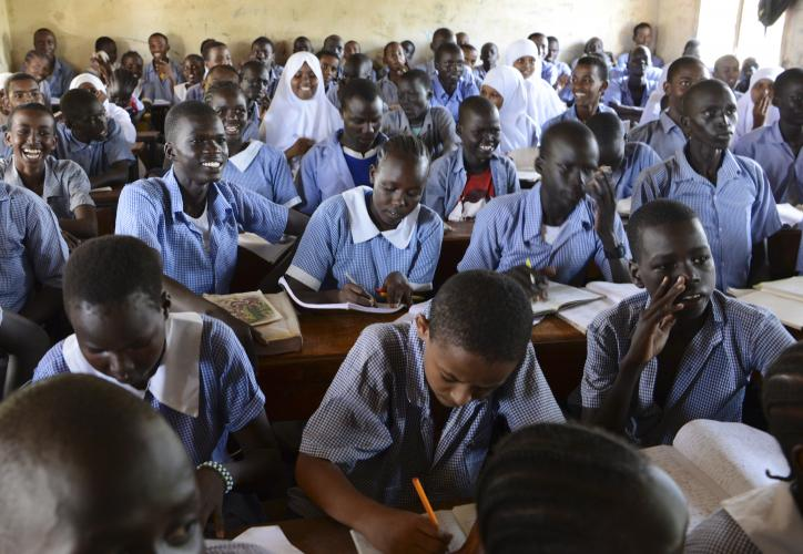 In Kakuma, it is common for students of many ages to learn together in a single classroom. Image by Rodger Bosch for UNICEF USA. Kenya, 2018.