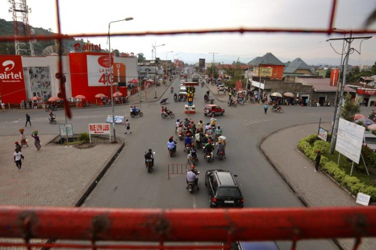 The streets of Goma are filled with motorbike taxis. Image by Peter Yeung / LA Times. Congo, 2020.