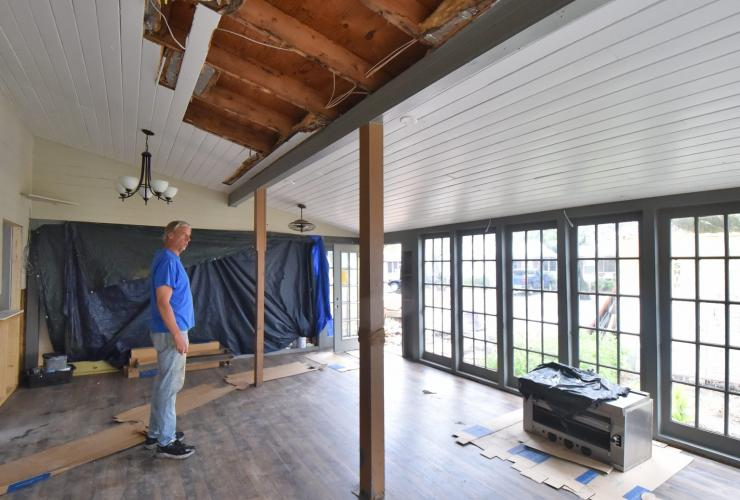 Doug Eifert, co-owner of Dajio on Ocracoke Island is shown last week in the restaurant's main dining room, which is still under repair from damage sustained during Hurricane Dorian. Image by Dylan Ray. United States, 2020.